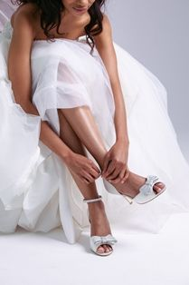 Imaani Zuri has a chic and elegant double bow which is covered in shiny mother of pearl Crystal trims, to compliment the trims on the removable ankle strap. Bridal Shoes, Wedding Shoes, On Your Wedding Day, Compliments, Ankle Strap, White Dress, Pearl, Bows, Crystal