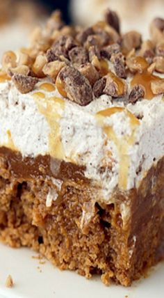 Double Pumpkin Poke Cake Recipe ~ The pudding adds an incredibly moistness to the cake, and topped with a decadent whipped cream it's to die for.