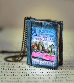 Alice's Adventures in Wonderland Book Necklace - Classic Literature - Jewelry… Book Necklace, Beloved Book, Book Jewelry, Disney Jewelry, Disney Rings, Adventures In Wonderland, Through The Looking Glass, Sea Glass Jewelry, Patch