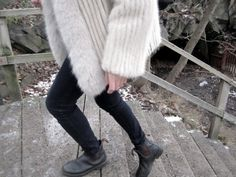 White fox fur, black jeans, black booties