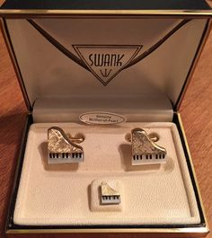These stunning cufflinks by SWANK feature figural textured gold tone grand pianos whos keys are inlaid with gorgeous Mother of Pearl. They are from