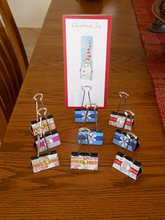 Use bull clips to hold up signs at centers or to display finish art work.