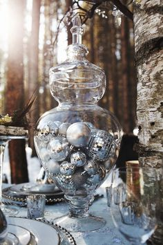 Fill an apothecary jar with silver balls. This decor is a great accent to black and adds some POP to a centerpiece. www.celebrationsbykat.com