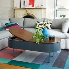 Just like its gemstone namesake, the Ruby Storage Coffee Table stands out with its disc-shaped feet and bright, Petrol Blue metal frame. This clever multi-tasker hides anything you want to keep within reach but out of sight—its top has tw Coffee Table Stand, Oval Coffee Tables, Solid Wood Coffee Table, Coffee Table With Storage, Storage Benches, Table Storage, Furniture For Small Spaces, Kids Furniture, Modern Furniture