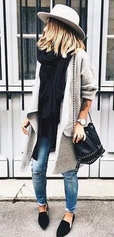 Gray cardigan with black tee and blue jeans.
