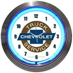 Chevrolet Truck Service Neon Clock with white background and blue circular neon tubing. Chevrolet Truck Service lettering and the Chevy Bowtie emblem in the center. Each clock features a hand blown ri