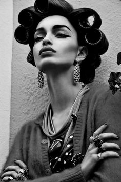 liquid eyeliner. hair make up updo style. black and white fashion photography.