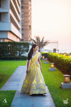Sangeet Lehengas - Yellow and Silver Engagement Lehenga | WedMeGood | Yellow Silk Lehenga with Silver Embroidered Motifs with a Silver Blouse and Yellow Dupatta #wedmegood #indianbride #indianwedding #yellow #lehenga