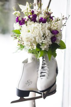 Winter wedding photo - ice skates and bouquet