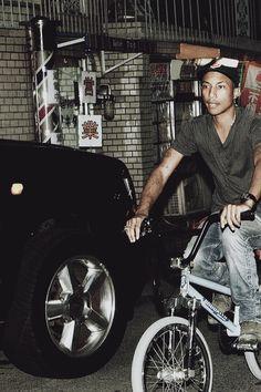 Pharrell riding a bike and still very sexy