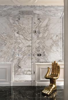 Lenny Kravitz Paris apt bathroom carrera marble glam Pedro Friedeberg hand chair
