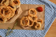 BAKED ROSEMARY ONION RINGS  ~~~  How have I never made onions rings at home before?  Needless to say, they're awesome.  As much as I love onion rings, I couldn't bring myself to buy deep fried, over salted onion rings to satisfy my cravings.  I had seen baked onion rings on other blogs before but figured it was too much work or that they wouldn't be as good.  Um… About that?  I wont be going back to regular deep fried, ov