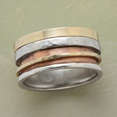 """DUET RING--Mixed-metal band embraces a rotating ring of yellow gold. 14kt rose gold and sterling silver. Whole sizes 5 to 12. 3/8""""W. This ring is licensed under U.S. Patent Nos. 6,497,117 and 6,395,732."""