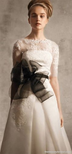 A VERA WANG DRESS! Love this dress super modest besides the big black bow! Definitely what I'm dreaming of for my wedding!