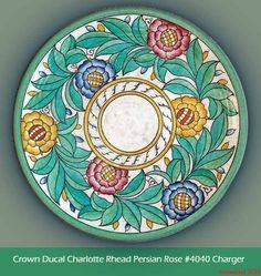 Charlotte Rhead Charger | Crown Ducal, Persian Rose Pattern # 4040 | Stylised rose heads with a double row of petals and cross-hatched centres. Enamelled in pink, orange, red & blue with green leaves and finished with a green border. | 12.5 inches diameter | #charlotte_rhead