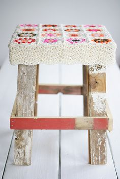 Love this stool made out of scrap wood.  Like the crochet cover too
