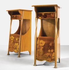 ** A WALNUT AND FRUITWOOD MARQUETRY CABINETS BY LOUIS MAJORELLE, CIRCA 1900
