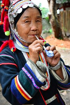 hilltribe she is smoking elephant ceramic pipe