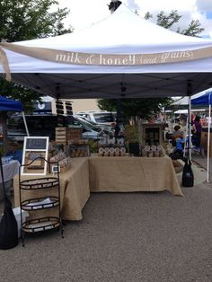 Milk & honey (and grains) farmers market stand. Burlap, weathered wood apple crates, and chalkboards used to display our healthy baked goods--granola and cookies.(Farmers Market Bake Goods)