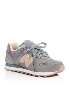 New Balance updates a signature sporty sneaker with lacy mesh panels and blush accents for feminine flair.   Suede and mesh upper, textile lining, rubber sole   Imported   Fits true to size, order you