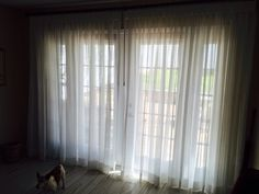 Gorgeous custom sheer drapes from Signature Series Inspired Drapes line available at Budget Blinds