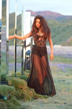 Selena Gomez in stunning behind the scenes snaps of new video Come & Get It
