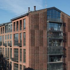 DNK Architecture Group has turned a Moscow furniture factory into Rassvet Loft Studio apartments, replacing its concrete panels with hand-made bricks. Open Architecture, Beautiful Architecture, Loft Style Apartments, Studio Apartments, Underwater Restaurant, Tower Block, Small Terrace, Attic House, Dormer Windows