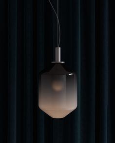 Modern hanging lamp with a soft, ombre geometric silhouette