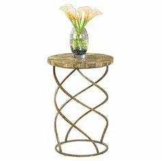 """End table with a fossil stone top and twisting metal base.  Product: End tableConstruction Material: Metal and fossil stoneColor: GoldDimensions: 26"""" H x 12"""" Diameter"""