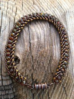 Flat spiral bracelet made with Czech glass