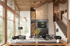 A ski-in/ski-out chalet was transformed into a breathtaking home with bright interiors by designer Robert Bailey in Whistler, British Columbia, Canada.