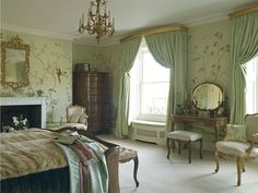 I love the wallpaper and the colors. The furniture is quite nice as well except for maybe the bed. Well done bedroom decor from Spenser-Churchill Designs.