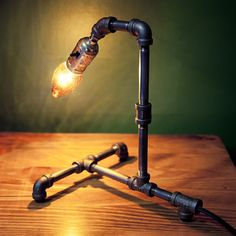 Custom iron pipe lamp. Don't like the design, but fun idea.   # Pin++ for Pinterest #