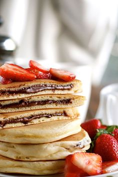 Nutella Pancakes - frozen Nutella discs makes it a breeze to make these Nutella stuffed pancakes! www.recipetineats.com
