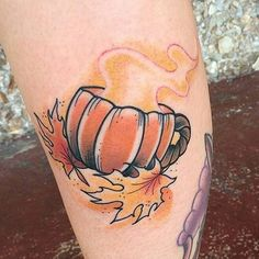 A really cute pumpkin Halloween tattoo design. The light color help make the design look very welcoming and pleasant. You can also see that the pumpkin is lighted to celebrate Halloween.