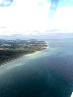 Flying over Dublin Bay (in County Wicklow) from Newcastle Airfield (99eur for one 45-min lesson)