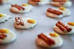 Bacon & Eggs Circle of melted white chocolate, 1yellow M for the yolk, and 2 little pretzel sticks for bacon.