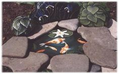 stone painted fish pond