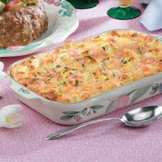 Golden Shrimp Brunch Casserole ~I will use a different cheese, sourdough bread (and less bread), sub sour cream for some of the milk, and add green onions to the top......and maybe a bit of garlic, lemon zest, & cayenne in the casserole.