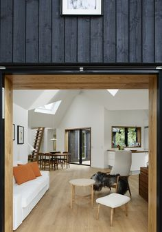 Danish Summer House by Powerhouse Company   stained black exterior and light-filled white interior