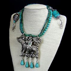 Custom Designed Necklace by Liz Wolter 2013; Tibetan Dragon Focal Pendant, Turquoise, Tibetan and Sterling Spacers, Beads, Clasp.