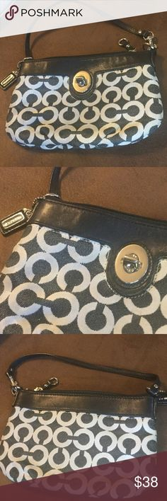 "COACH WRISTLET! Blue material and leather WRISTLET.  8.5"" wide, 5.5"" tall.  Strap extends 5"" and can be converted to a wristlet (see pic4).  Blue and white monogram design.  Clean inside and out. NS071030 Coach Bags Clutches & Wristlets"