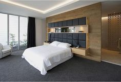 BEDHEAD Built in bedside tables, panelled bedhead and timber dividing wall to wardrobe.