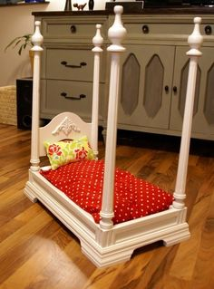 Upside down discarded table makes a royal bed for a pet.
