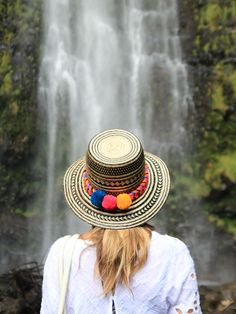 Blog Post: { Maui, Hawaii } Waikomu Falls, Travel Photo by @chrissihernandez | Gorgeous hat with colorful poms, staring into the beauty of Waikomu Falls on the Road to Hana