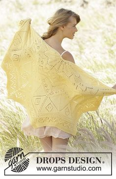 Knitted DROPS shawl in garter st with lace pattern and zig zag pattern in Cotton Merino Free knitting pattern by DROPS Design.