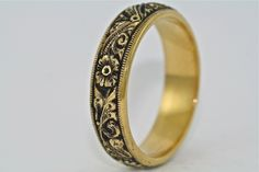 14kt Black and Yellow Gold Hand Engraved Wedding Band by MasterPieceJewelers on Etsy https://www.etsy.com/listing/183821817/14kt-black-and-yellow-gold-hand-engraved