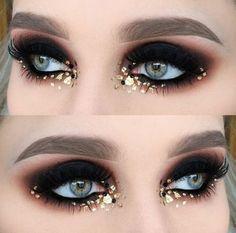 Dark black eyeshadow with gold flecks