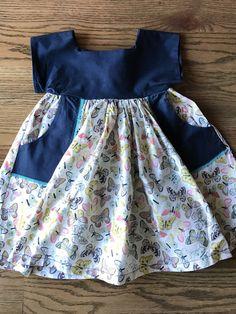 Butterfly dress with pockets, Navy Blue, Girls Butterfly dress, Luna dress by AudreyandAverie on Etsy https://www.etsy.com/listing/494479930/butterfly-dress-with-pockets-navy-blue