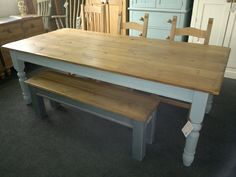 Waxed plank top table on 4'' farmhouse turned legs painted 'lulworth blue' & square leg bench in 'pavilion grey'.